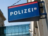 This picture taken in Vienna on September 6, 2012 shows a sign of the Polizei, Austria's Police department.