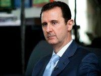 A handout picture released by the Syrian Arab News Agency (SANA) on January 15, 2015 shows Syrian President Bashar al-Assad giving an interview to the Eterarna Novina Czech newspaper in Damascus. Coalition strikes against the Islamic State group are having no impact, Assad said in an interview, as members of …