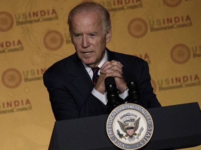 Vice President Joe R. Biden speaks during a reception for the US-India Strategic and Commercial Dialogue Summit at the Andrew Mellon Auditorium September 21, 2015 in Washington, DC. AFP PHOTO/BRENDAN SMIALOWSKI (Photo credit should read