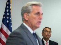 House Majority Leader Kevin McCarthy (R-CA) (L) speaks as Speaker of the House John Boehner (R-OH) looks on during a press conference after a closed meeting with fellow Republicans, on Capitol Hill, July 28, 2015 in Washington, DC. The House plans to move on Wednesday to extend highway and transit …