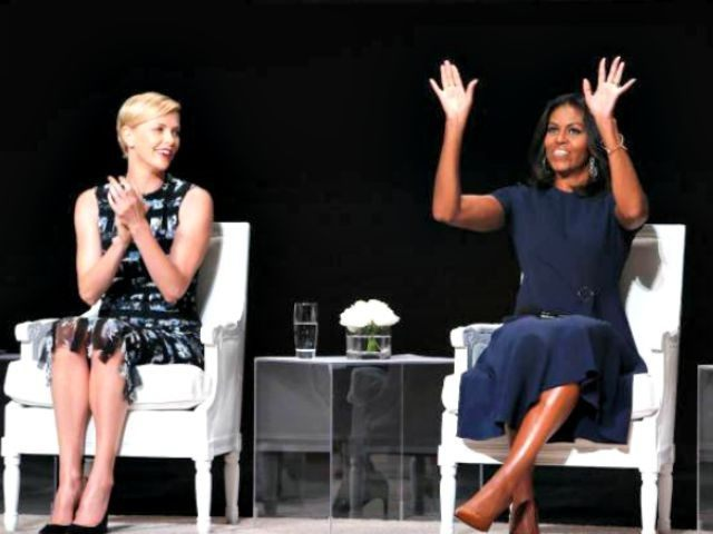 Charlize Theron and Michelle Obama AP