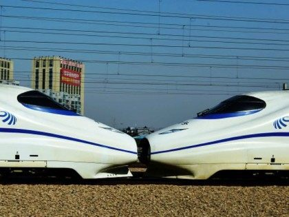 This photo taken on December 30, 2014 shows high-speed trains on the railway in Hangzhou, in eastern China's Zhejiang province. The merger of China's top two train makers will create a 'world-leading' rail supplier to compete with foreign players, they said, as enthusiastic investors sent their share prices surging on …