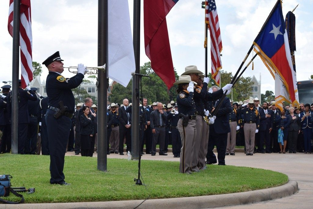 Honor Guard duet plays Taps in honor of Deputy Goforth.