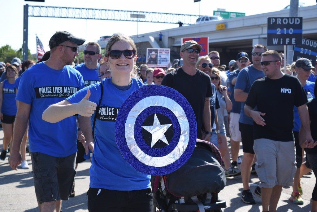 Marcher gives thumbs up to Captain America. (Photo: Breitbart Texas/Bob Price)