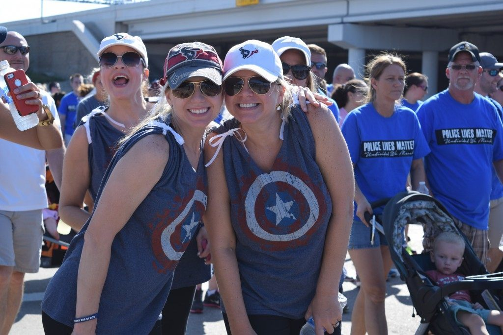 Marchers wearing Captain America shirts joined in the sea of blue Police Lives Matter shirts. (Photo: Breitbart Texas/Bob Price)