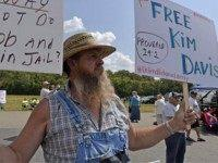 Coleman Colston of Henry County, Ky., joins in the protest in support of jailed Rowan county cerk Kim Davis at the Carter County Detention Center in Grayson, Ky., Tuesday, Sept. 8, 2015. After five days behind bars, Davis was ordered released from jail Tuesday by the judge who locked her …