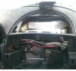 Cocaine bundles can be seen where the vehicle's airbag should have been.