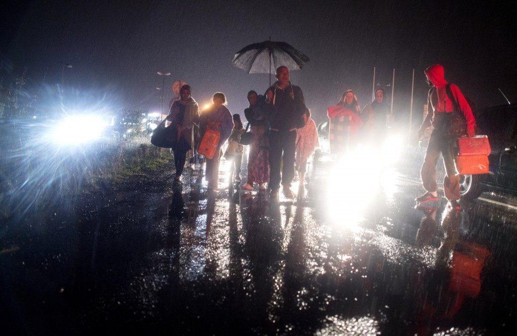 Migrants who are entering Austria on foot walk towards the village Nickelsdorf. (JOE KLAMAR/AFP/Getty Images)