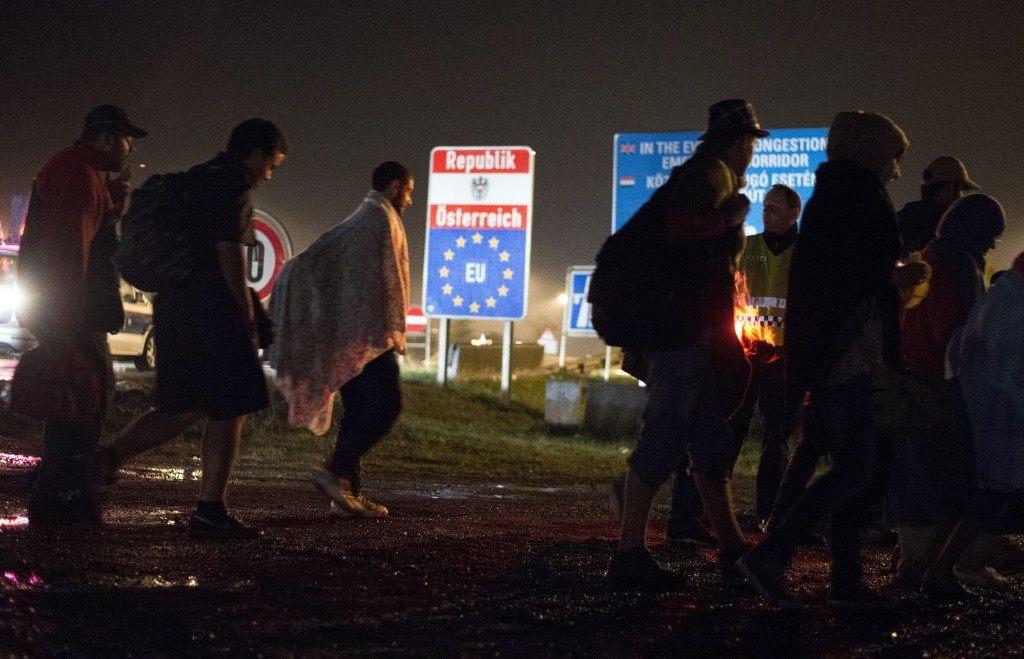 Migrants cross the Austrian border. (JOE KLAMAR/AFP/Getty Images)