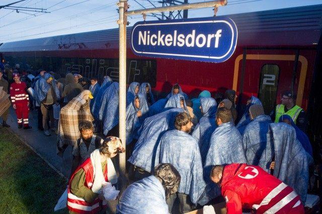 Migrants board a train in the village of Nickelsdorf (JOE KLAMAR/AFP/Getty Images)