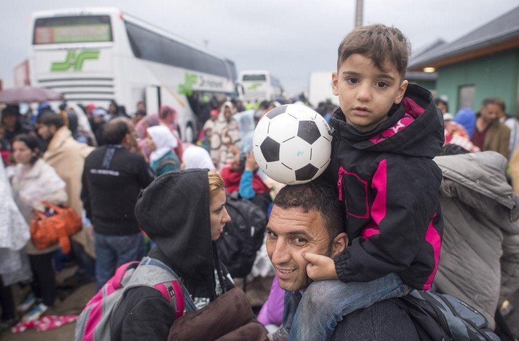 Migrants arrive on the Hungarian-Austrian border (JOE KLAMAR/AFP/Getty Images)