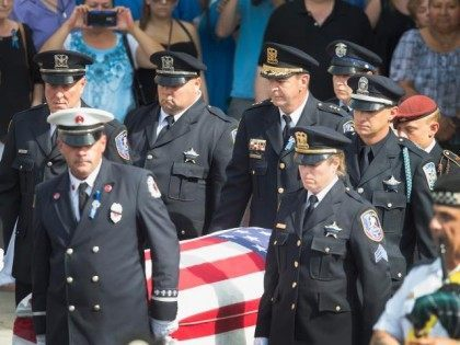 The casket bearing the body of Lt. Joe Gliniewicz is carried from the church by police officers, a fireman and an Army soldier. (Photo: Scott Olson/Getty Images)