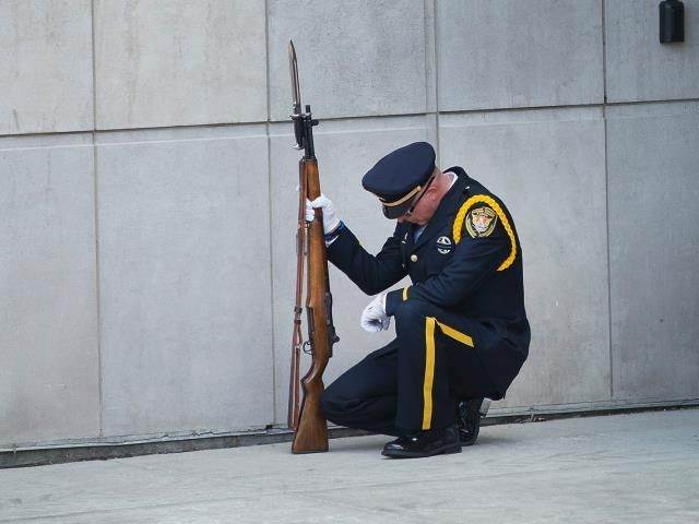 Caption:ANTIOCH, IL - SEPTEMBER 07: A police officer grieves the loss of slain Fox Lake police officer Lt. Joe Gliniewicz outside his funeral service at Antioch Community High School on September 7, 2015 in Fox Lake, Illinois. Gliniewicz was shot and killed on September 1, while on duty in Fox …