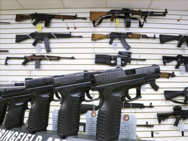 FILE - In this Jan. 16, 2013 file photo, assault weapons and handguns are seen for sale at Capitol City Arms Supply in Springfield, Ill. In a questionnaire for The Associated Press, the four GOP candidates for governor, state Sens. Bill Brady and Kirk Dillard, state Treasurer Dan Rutherford and …