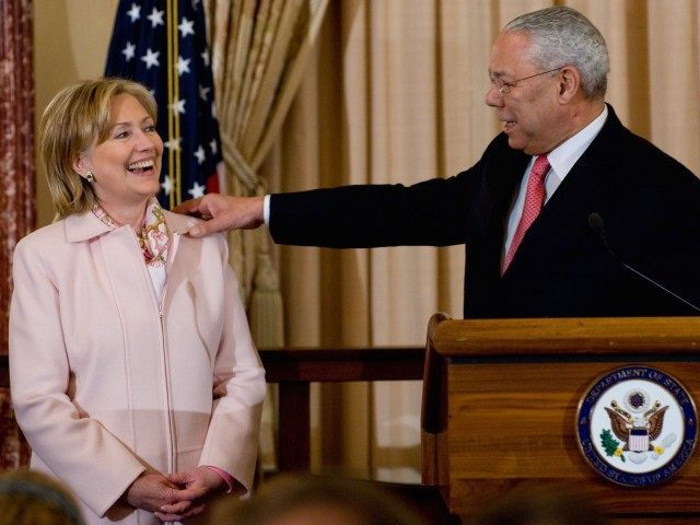Hillary Clinton and Colin Powell (Saul Loeb / AFP / Getty)