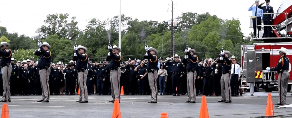 Harris County Sheriff's Honor Guard fires a 21-gun salute.