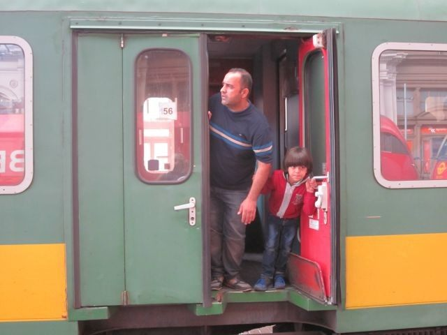 Asylum seekers wait aboard there train in Budapest for the trip to the Austria border.