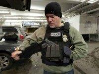 "In this March 2, 2015 photo, an Immigration and Customs Enforcement officer ""tacs up"" in the garage of a New York federal building, as he prepares for series of early-morning arrests. Immigrant and Customs Enforcement say an increasing number of cities and counties across the United States are limiting cooperation …"