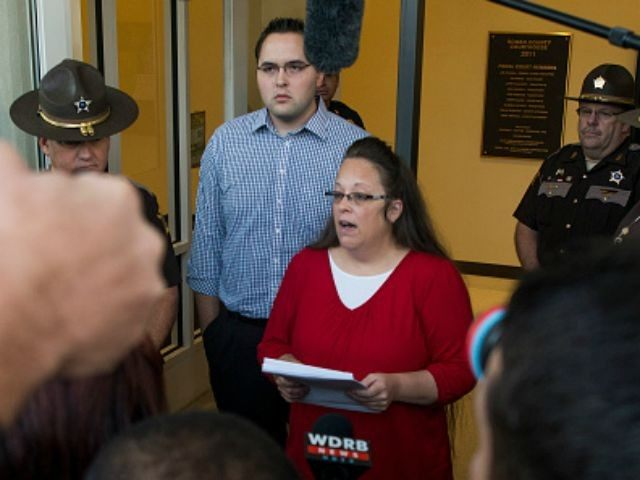 Rowan County clerk Kim Davis gives a statement about her intentions on applying her signature to same sex marriage licenses on her first day back to work, after being released from jail last week, at the Rowan County Courthouse September 14, 2015 in Morehead, Kentucky. Davis was jailed for disobeying …