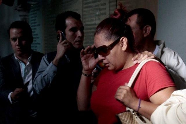 Gabriela Bejarano, sister of Rafael, one of the eight Mexicans killed in an incident in Egypt, leaves the Government Palace after a meeting with local officials in Guadalajara