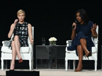 Former Australian Prime Minister Julia Gillard, Founder of Charlize Theron Africa Outreach Project and U.N. Messenger of Peace Charlize Theron and First Lady of the United States Michelle Obama join Glamour 'The Power Of An Educated Girl' panel at The Apollo Theater on September 29, 2015 in New York City. …