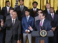 President Barack Obama holds up two fingers to indicate the number of times that the Duke basketball team has been honored at the White House as head coach Mike Krzyzewski (R) speaks during an event in honor of the Duke Blue Devils Mens Basketball team and their 2015 NCAA Championship …