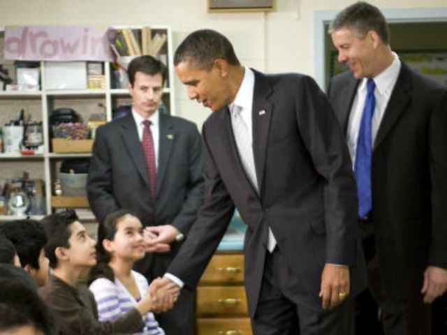 President Barack Obama and Secretary of Education Arne Duncan (R) visits with sixth grade students at the Graham Road Elementary School January 19, 2010 in Falls Church, Virginia. Following his meeting with students the President will deliver remarks on his 'Race to the Top' program and his request for an …