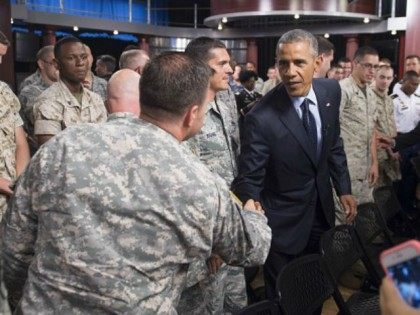 Barack Obama greets troops after holding a 'Worldwide Troop Talk,' a town hall with US members of the military around the world broadcast from Fort Meade in Maryland, September 11, 2015, on the 14th anniversary of the 9/11 attacks on the United States. AFP PHOTO / SAUL LOEB (Photo credit …