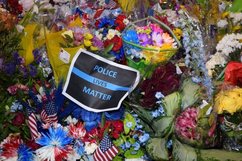 "Police Lives Matter sign with the ""Thin Blue Line"" emblem on display during the vigil. (Photo: Breitbart Texas/Bob Price)"