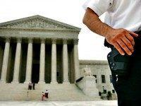 Policeman with Gun at Supreme Court Jacquelyn MartinAP Photo