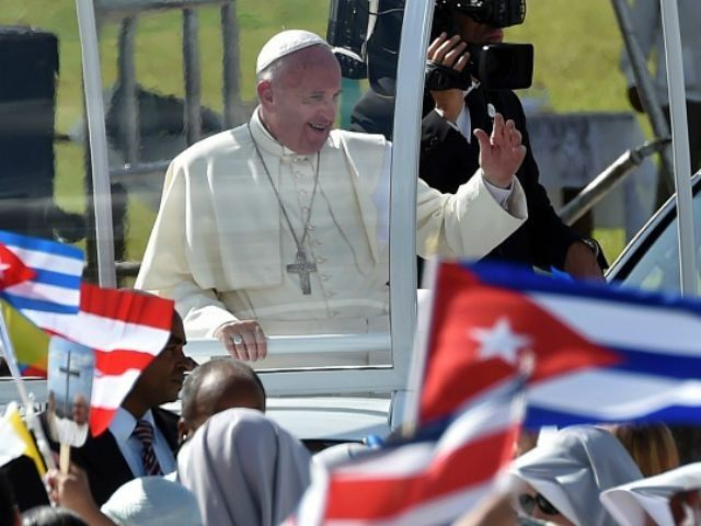 Pope Francis waves at the crowd as he arrives to give a morning mass at the Calixto Garcia square in Holguin, in eastern Cuba, on September 21, 2015. Holguin, a cradle of Catholic faith on the island and also the home region of communist leaders Fidel and Raul Castro, is …