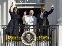 Barack Obama, First Lady Michelle Obama and Pope Francis wave during an arrival ceremony on the South Lawn of the White House in Washington, DC, September 23, 2015. More than 15,000 people packed the South Lawn for a full ceremonial welcome on Pope Francis' historic maiden visit to the United …