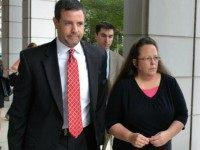 Rowan County Clerk Kim Davis, right, walks with her attorney Roger Gannam into the United States District Court for the Eastern District of Kentucky in July. The Rowan County, Ky., clerk's office turned away gay couples who sought marriage licenses on Thursday, defying a federal judge's order that said deeply held Christian beliefs don't excuse officials from following the law.