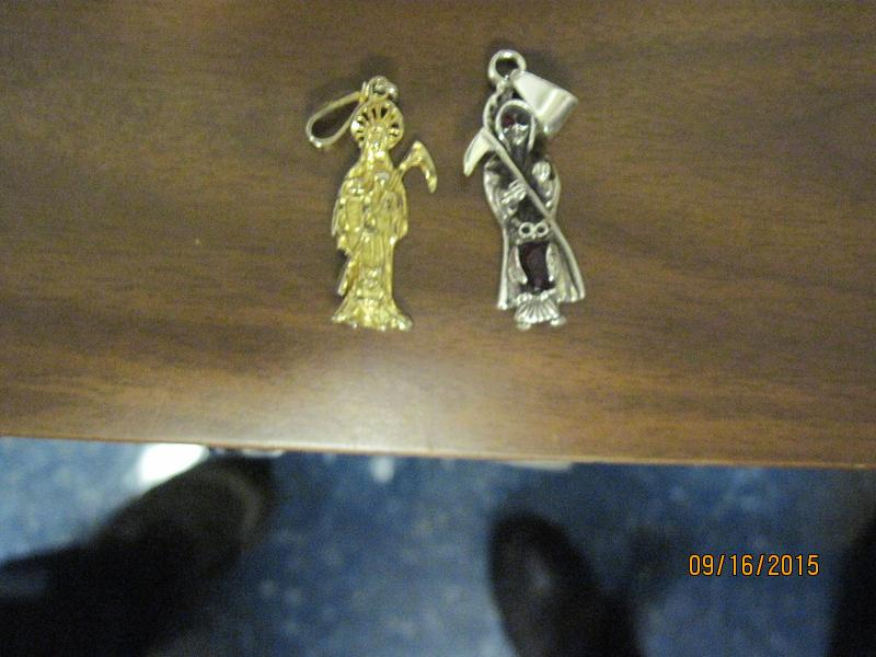 Two Santa Muerte pendants worn by cocaine smuggling suspect. (Photo: U.S. Customs and Border Protection)