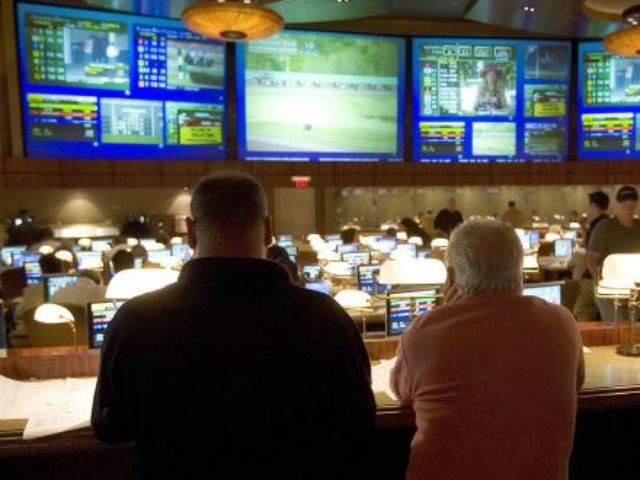 Players watch horse racing at the Race Book at the Borgata Hotel Casino and Spa in Atlantic City, New Jersey, 25 May 2007. The hotel, which opened in 2003 and features 2,000 rooms, touts itself as the first Las Vegas style resort in Atlantic City. Gambling has been legal in …