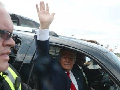 Republican presidential candidate Donald Trump (C) waves from his motorcade as he leave the National Federation of Republican Assemblies (NFRA) Presidential Preference Convention at Rocketown on August 29, 2015 in Nashville, Tennessee. GOP front runner Donald Trump leads most polls in the race. (Photo by