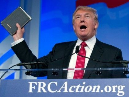 Donald Trump holds up his Bible while speaking at the Values Voter Summit in Washington on Sept. 25, 2015.