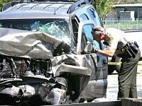 Vehicle hit by police sniper (Richard Brooks:The Press-Enterprise via AP)