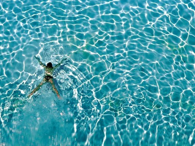 Woman in Pool Shaun Best AP