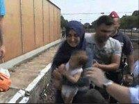 Distraught Syrian Family Lie on Train Tracks