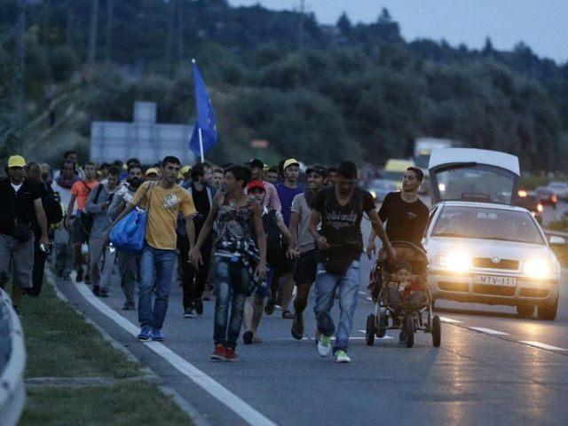 migrants-walk-out-of-Hungary-ap