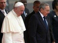 Pope Francis walks with Cuba's President Raul Castro (R) as he arrives at Jose Marti International Airport on September 19, 2015 in Havana, Cuba. Pope Francis is at the beginning of a three day visit to Cuba where he will meet President Raul Castro and hold Mass in Revolution Square …