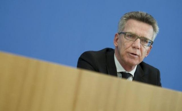 File photo of German Interior Minister de Maiziere presenting a draft law at a news conference at the Bundespressekonferenz in Berlin