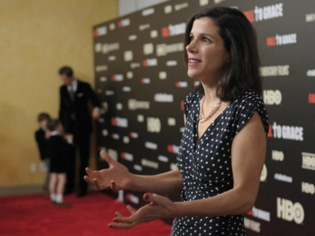 Filmmaker Alexandra Pelosi is interviewed while her husband Michiel Vos and sons Paul Vos and Thomas Vos stand in the background during the New York premiere of the HBO documentary Fall to Grace at Time Warner Center Screening Room on March 21, 2013 in New York City.