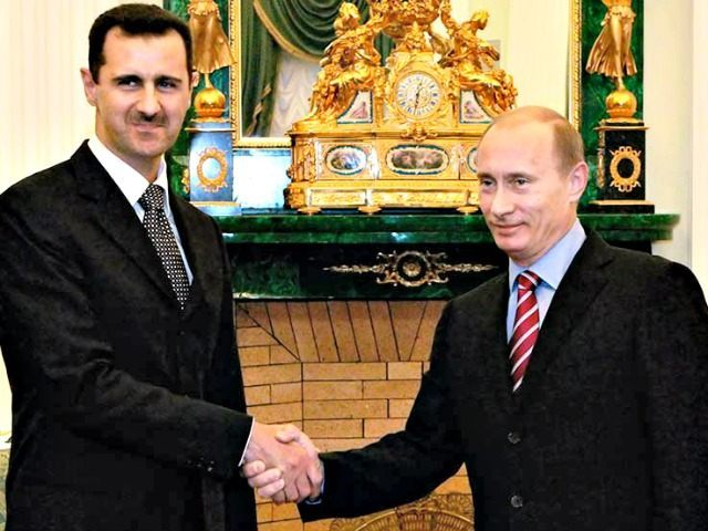 Assad and Putin Mikhail KlimentyevAP