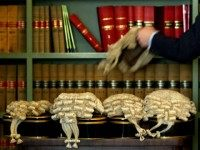 LONDON - MAY 7: A Barrister picks up his wig prior to British Home Secretary David Blunkett announcing changes to sentencing laws May 7, 2003 in London, England.