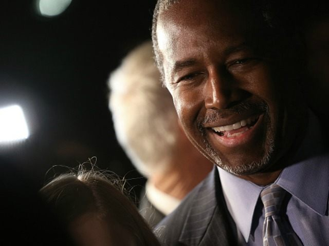 Republican presidential candidate Dr. Ben Carson greets supporters after delivering brief remarks at the King Street Retail Walk October 16, 2015 in Alexandria, Virginia. Carson discussed threats facing the United States during his remarks.