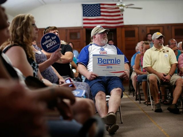 Iowa voters listen as Democratic presidential candidate U.S. Sen. Bernie Sanders (I-VT) speaks while campaigning at the IAFF Local 809 Union Hall August 16, 2015 in Clinton, Iowa. Sanders was scheduled for a full day of campaigning in eastern Iowa today.