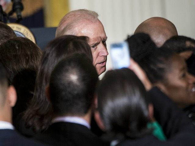 Joe R. Biden greets guests during an event to mark the 25th Anniversary of the White House Initiative on Educational Excellence for Hispanics in the East Room of the White House October 15, 2015 in Washington, DC. AFP PHOTO/BRENDAN SMIALOWSKI (Photo credit should read