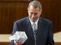 Outgoing Speaker of the House John Boehner, Republican of Ohio, holds up a box of tissues as he gives a farewell speech from the House floor at the US Capitol in Washington, DC, October 29, 2015. US Representative Paul Ryan, Republican of Wisconsin, is expected to become the new Speaker …